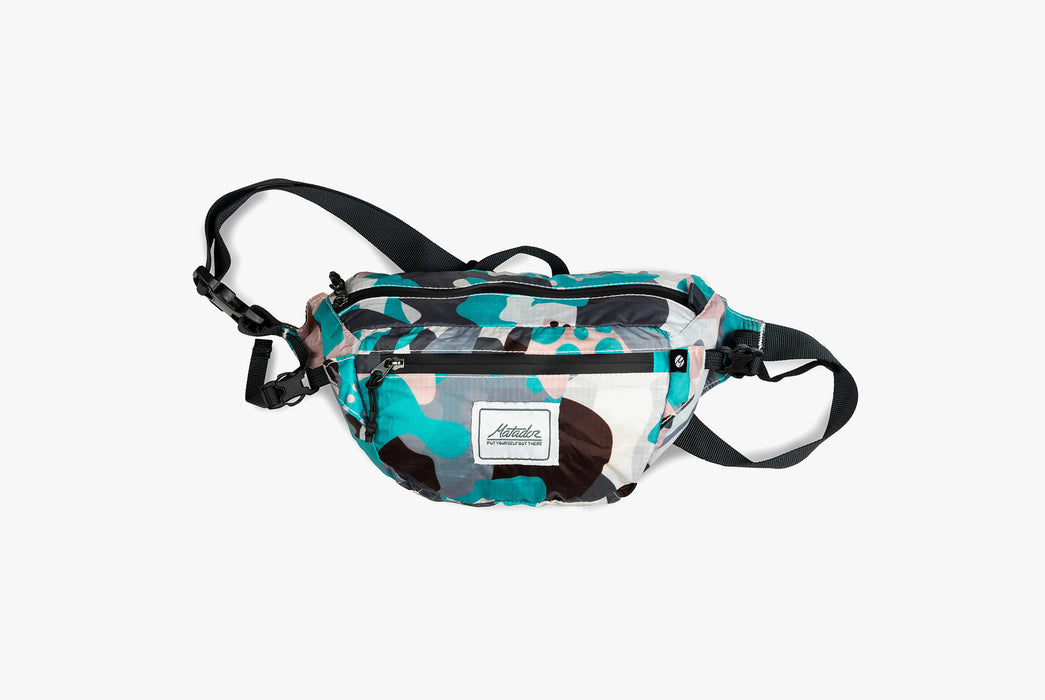 Matador Packable Hip Bag - Spot - Front view of pack that has turquoise, black, pink and white shapes on it