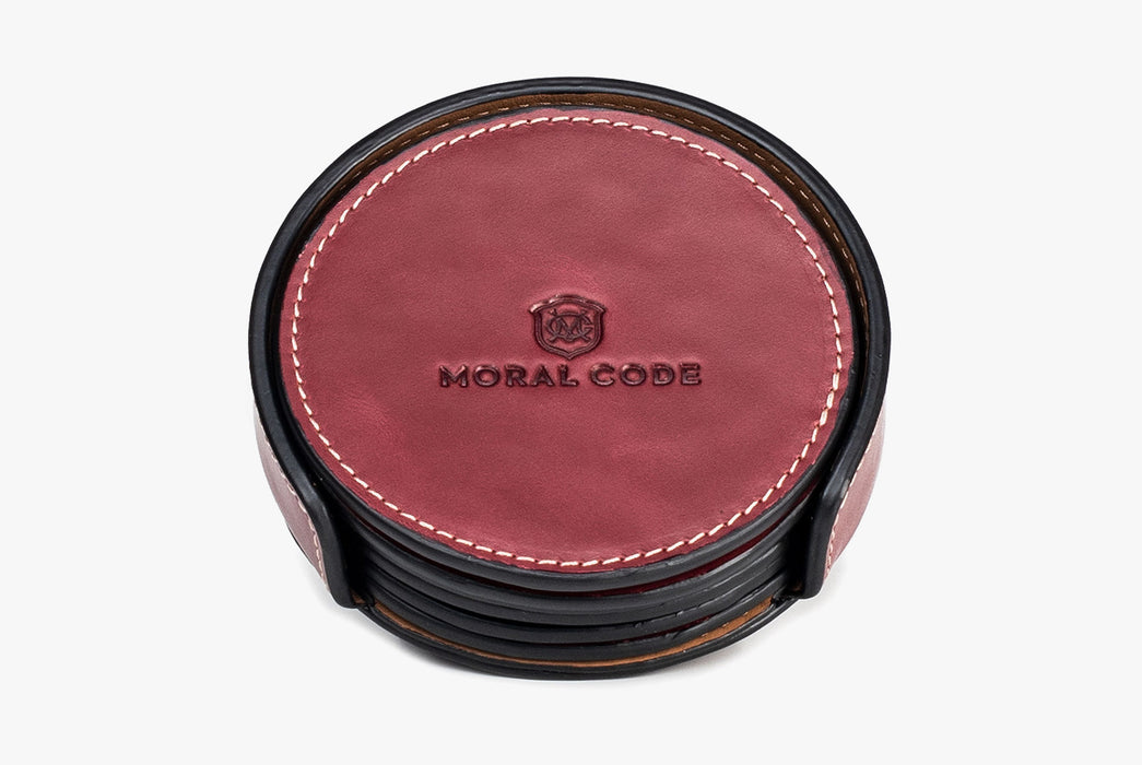 Moral Code Coasters - Red - stack of leather coasters in holder