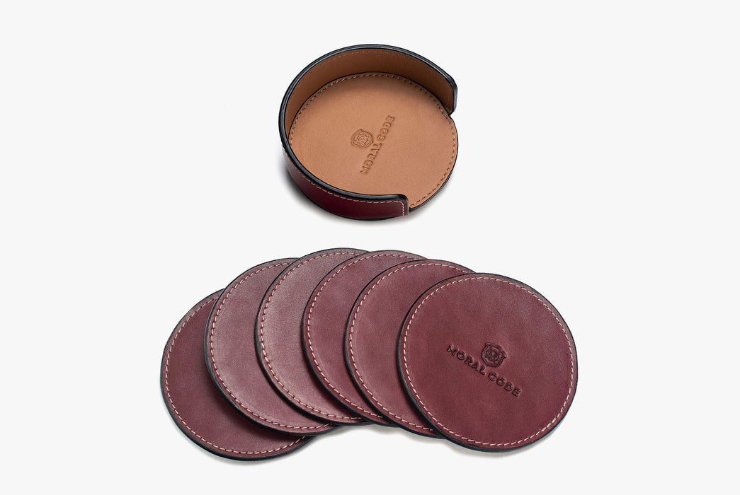 Moral Code Coasters - Red - leather coasters laying side by side below coaster holder