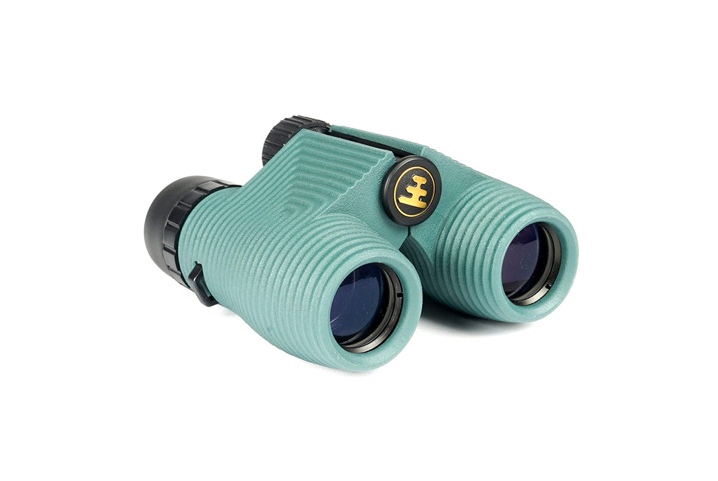 "Nocs Standard Issue 8x25 Waterproof Binoculars - ""Cypress "" (Turquoise) - side view of binoculars, showing grooved detailing"