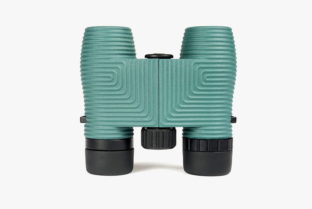 "Nocs Standard Issue 8x25 Waterproof Binoculars - ""Cypress "" (Turquoise) - binoculars standing up, lens-side down"