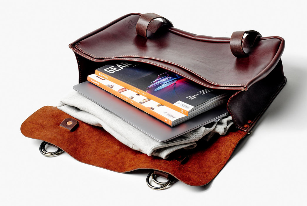 Orox Leather Co. Nuntius X Briefcase - Brown - open bag with magazines and a laptop spilling out over the top