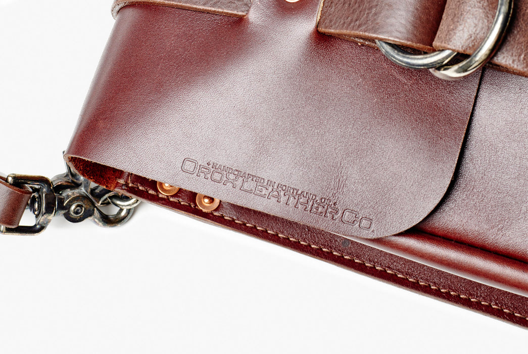 Orox Leather Co. Nuntius X Briefcase - Brown - close-up view of logo embossed in leather