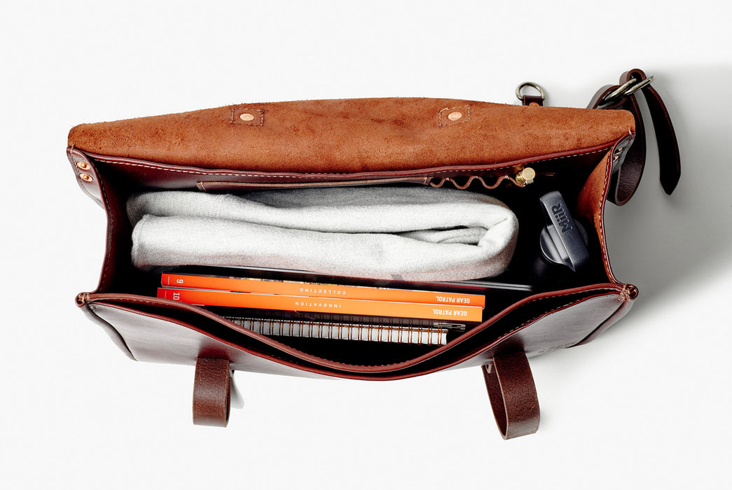 Orox Leather Co. Nuntius X Briefcase - Brown - top-down view of internal pockets, magazines, a water bottle, and other items