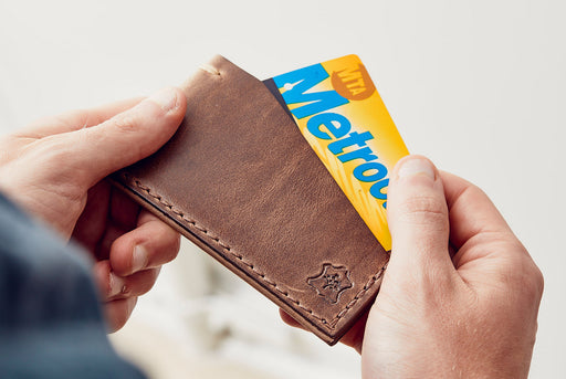 Orox Leather Co. Slim Cardholder - Natural - man taking a MetroCard out of the cardholder