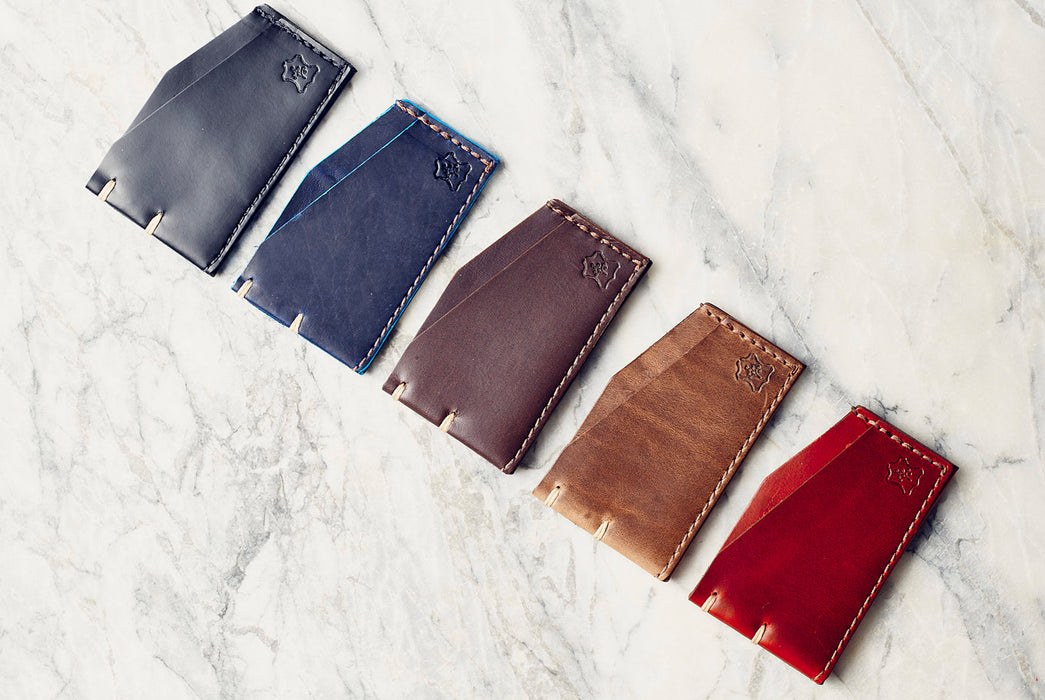 Orox Leather Co. Slim Cardholder - five different-colored cardholders laying side by side in a diagonal line