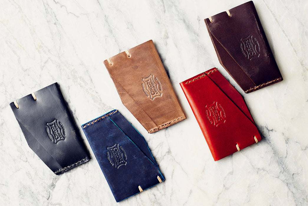 Orox Leather Co. Slim Cardholder - five different-colored cardholders laying staggered on a marble surface