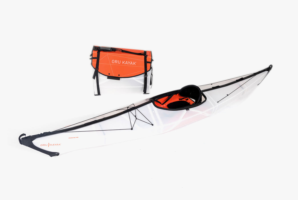 Oru Kayak - Bay ST - One kayak folded up next to one kayak fully assembled