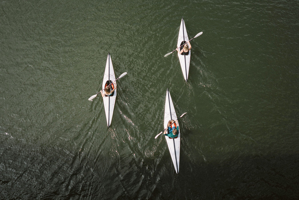 Oru Kayak - Bay ST - Top-down shot of three kayakers on a body of water