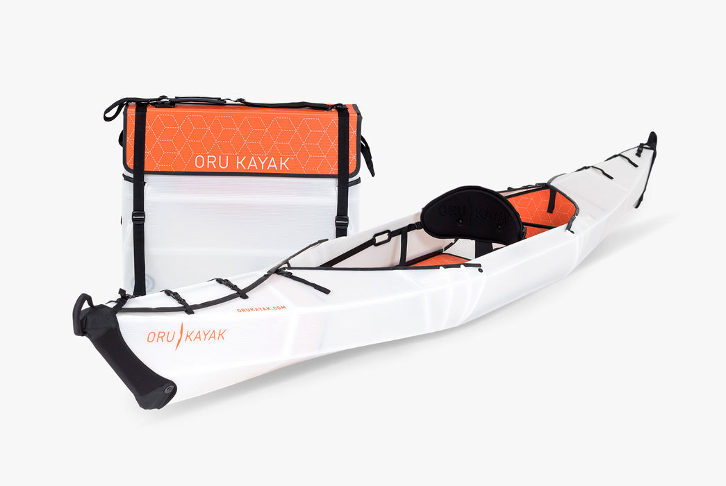 Oru Kayak - Beach LT - One folded-up kayak next to one fully assembled kayak