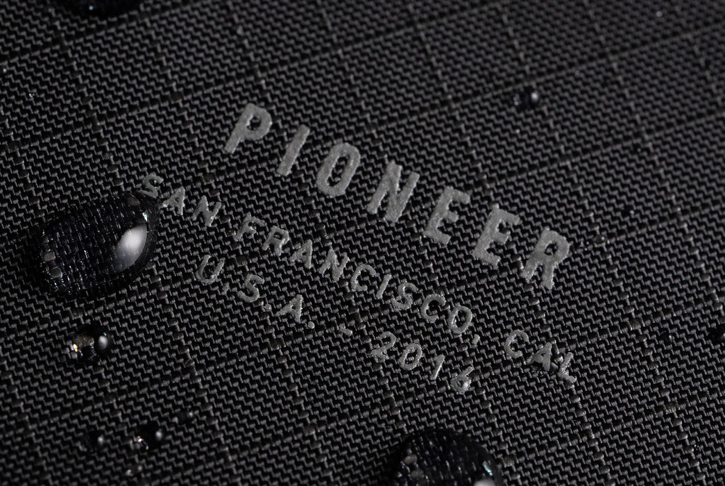 Onyx - Pioneer Flyfold Wallet - Close up on logo with water drops beading
