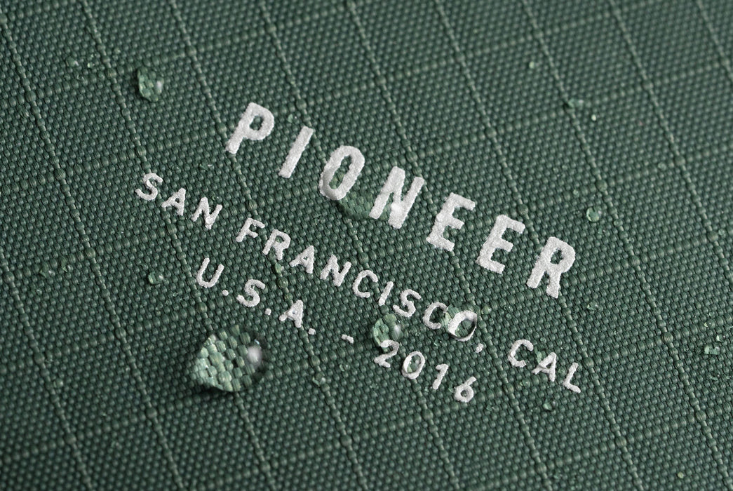 Evergreen - Pioneer Ion Wallet - Close up of logo with beading water