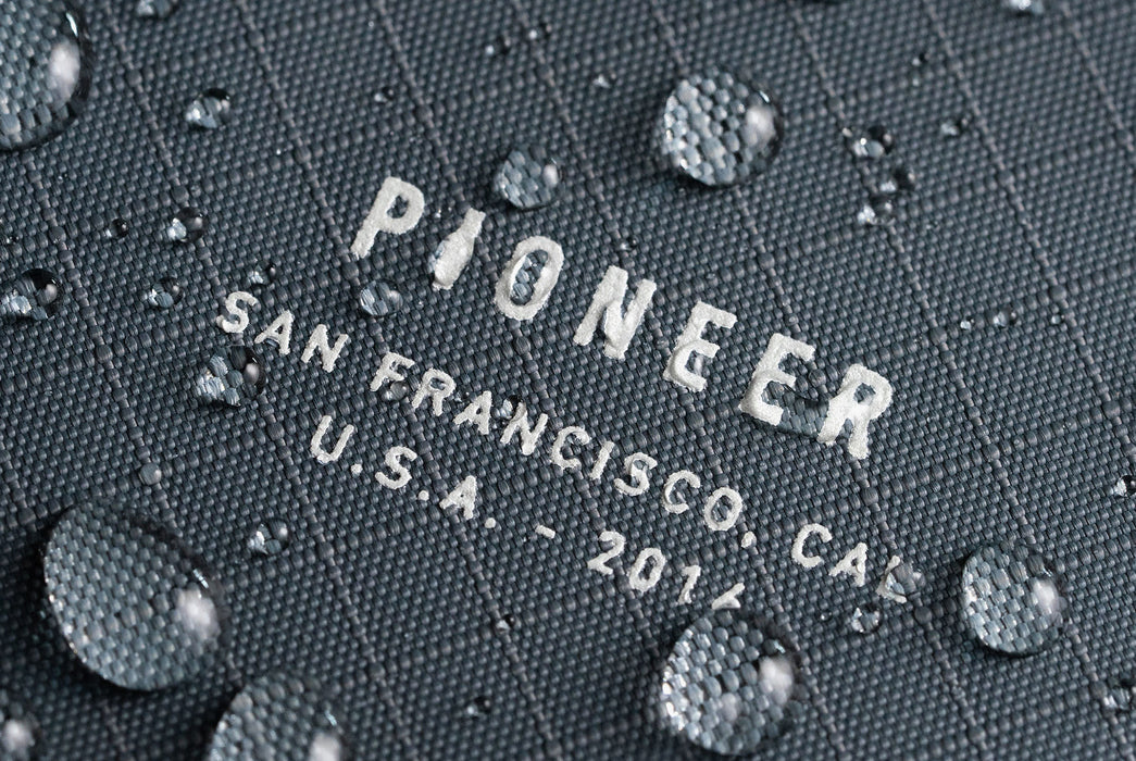 Slate - Pioneer Ion Wallet - Close up of logo with beading water