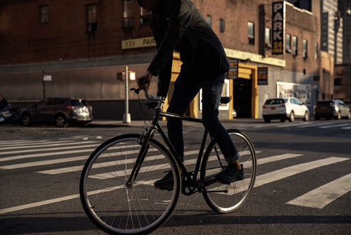 Black - Priority Bicycles x gear Patrol Commuter Bike - Person riding in city