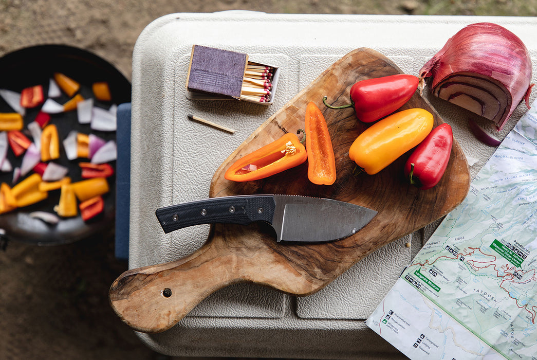 Black/Stonewashed - Quiet Carry Current - Knife on top of cooler with sliced vegetables