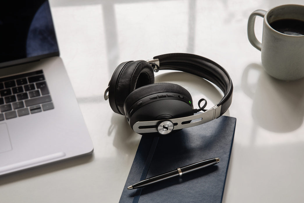 Black - Sennheiser Momentum 3 Wireless - On desk next to computer, coffee mug and notebook