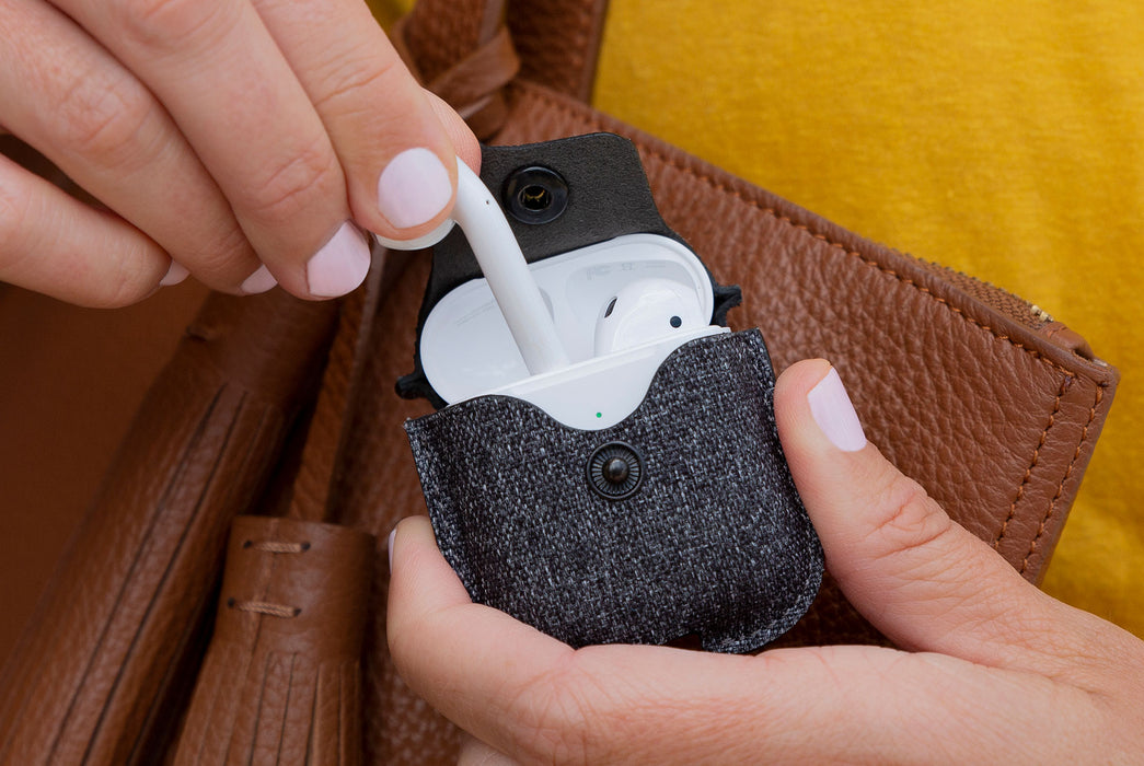 Twill Smoke - Twelve South AirSnap Case for AirPods - Person putting AirPod in case