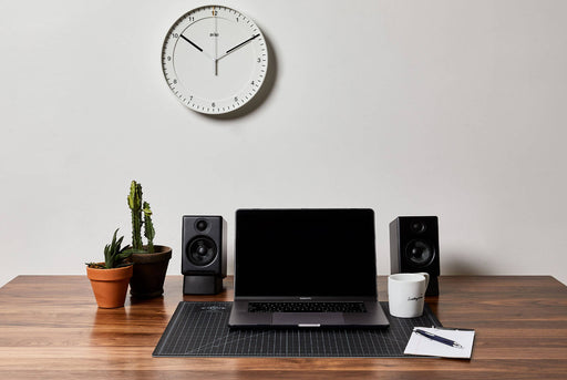 White Analog Clock - Front View Pictured Above Desk