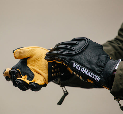 Black/Tan - Velomacchi Speedway Gloves - Person putting gloves on