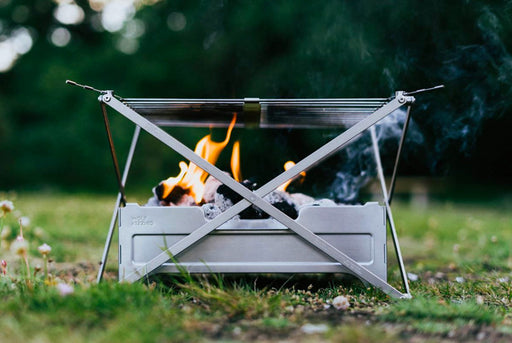 Wolf and Grizzly Campfire Trio Portable Grill and Fire Pit - Outside with fire in pit