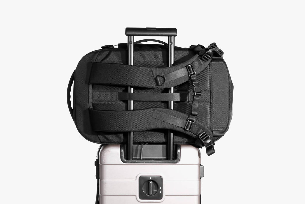 Black Travel Pack Attached to Suitcase via Luggage Strap - Rear View