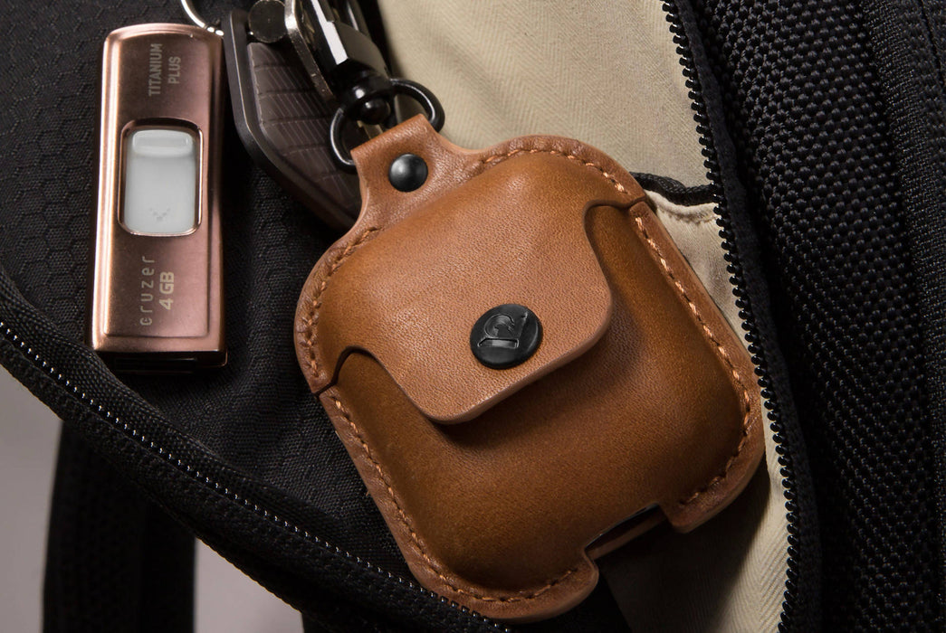 Cognac - Twelve South AirSnap Case for AirPods - Case clipped to bag