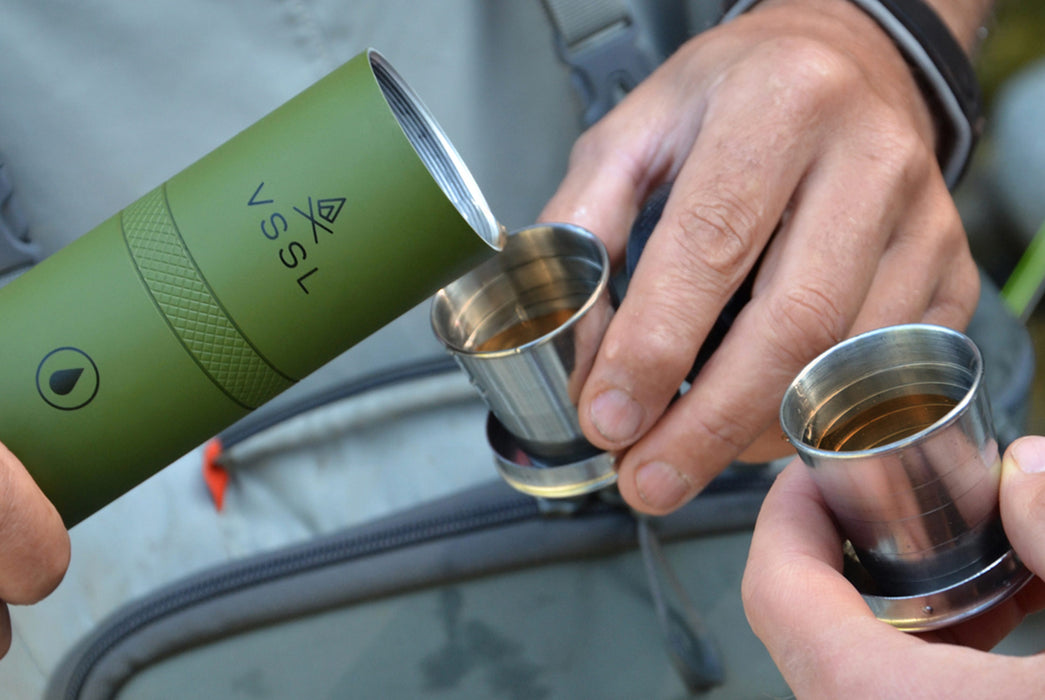 Green - VSSL Compact Adventure Flask - Person pouring liquid into cups