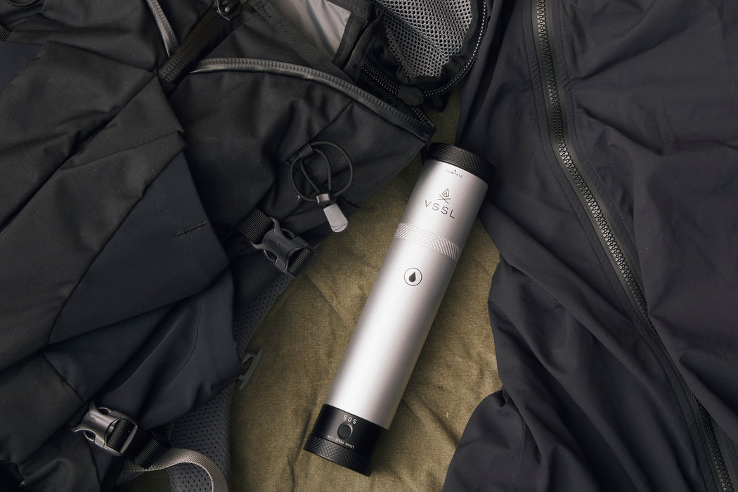 Silver - VSSL Compact Adventure Flask - Laying on clothing