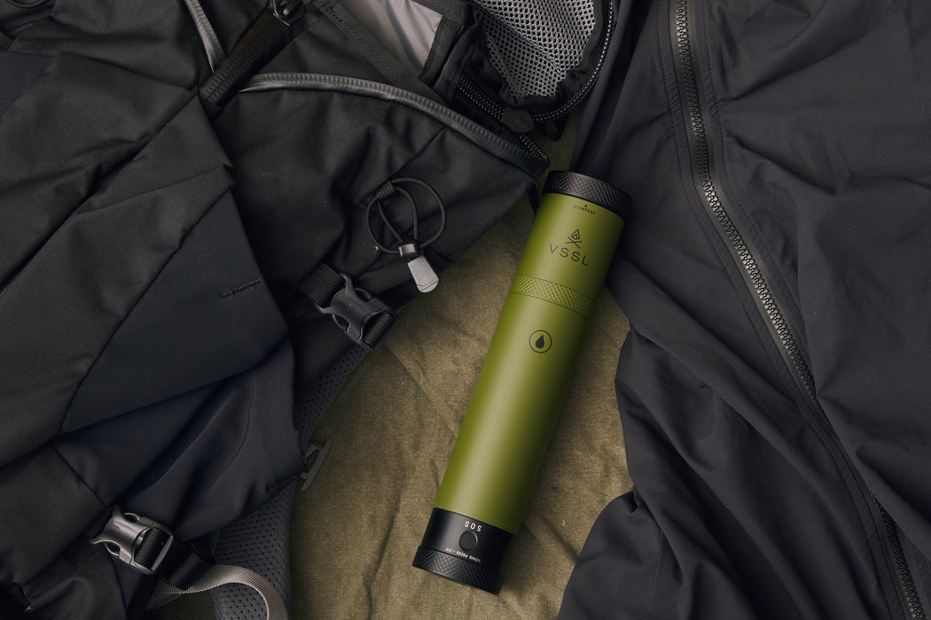 Green - VSSL Compact Adventure Flask - Laying on clothing