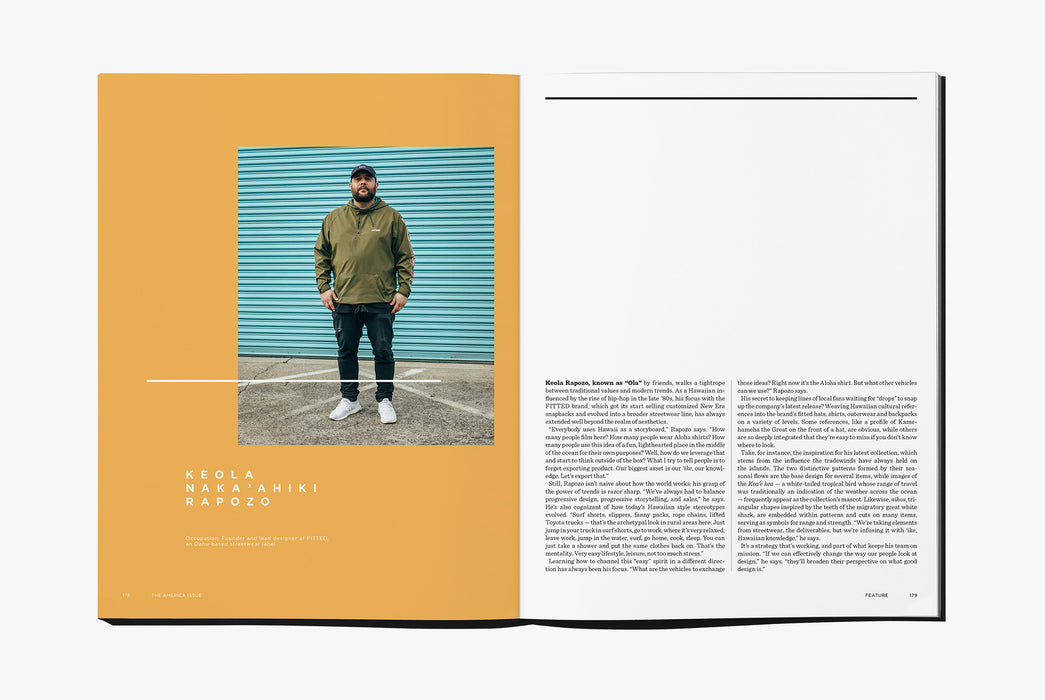 Gear Patrol Magazine: Issue Four - Open to spread showing a man wearing a windbreaker in front of a blue metal garage door