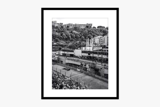 Grand Prix Print - black and white photo of racetrack with hills and a city in the distance, framed