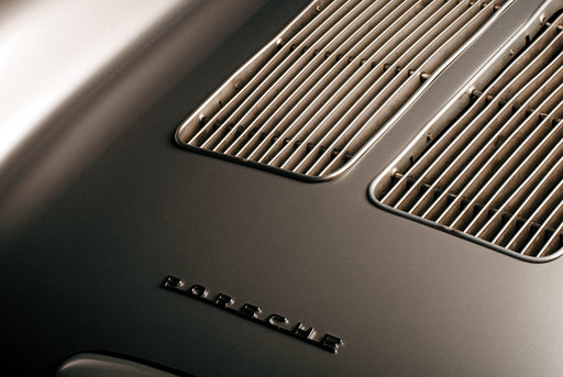 Unframed, zoomed-in photo of a Porsche grille