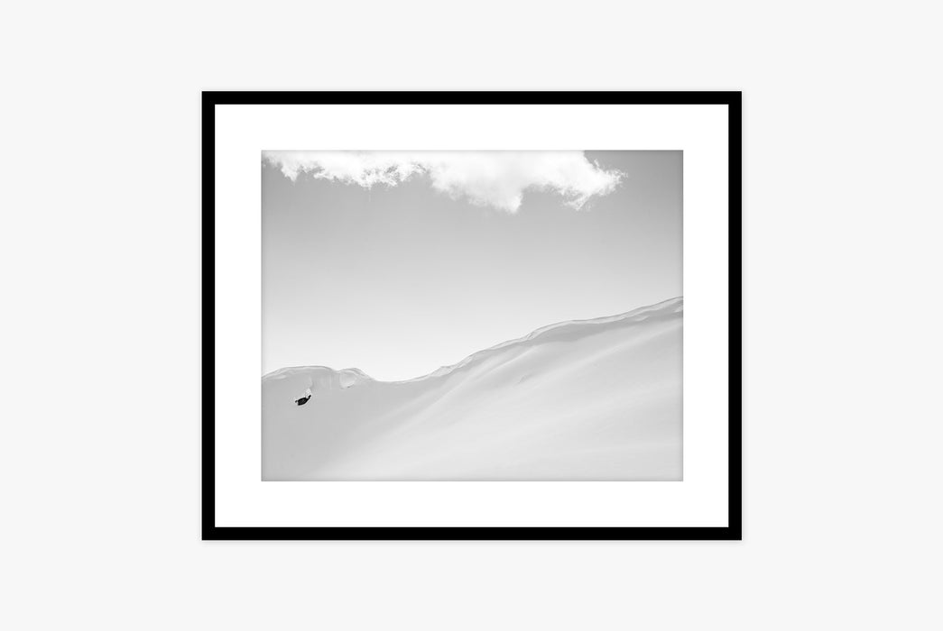 Framed photo of a snowboarder with snowy mountains all around