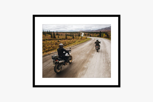 Framed Photo of Two Motorcycle Riders on Winding Road Lined by Trees