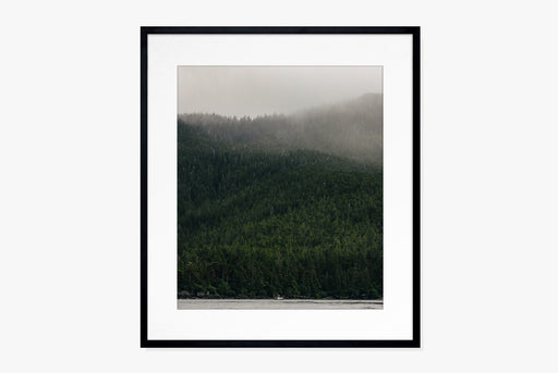 Norrland Print - framed photo of green expansive forest and fog overhead with boat on water