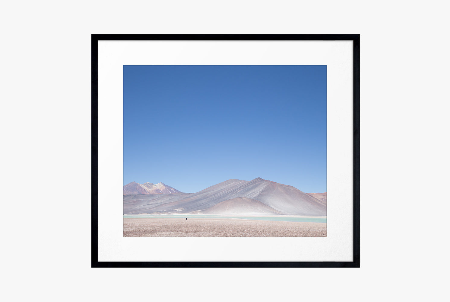 The Atacama Print - framed photo of a desert with mountains and a blue sky in the background