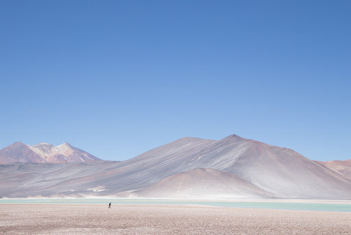 The Atacama Print - unframed photo of a desert with mountains and a blue sky in the background