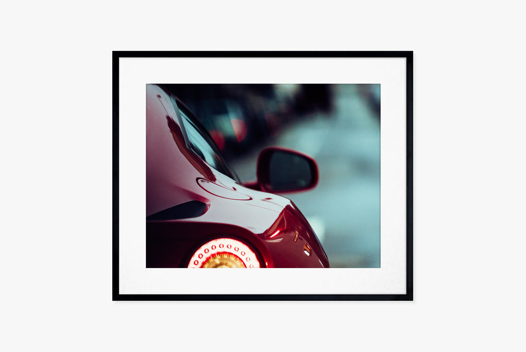 Photo of Red Ferrari in Black Frame
