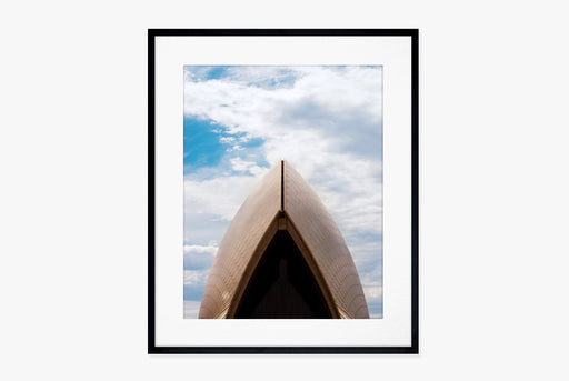 Sydney Opera House Print - framed close-up of the arch of the Sydney Opera House in front of a blue, cloudy sky