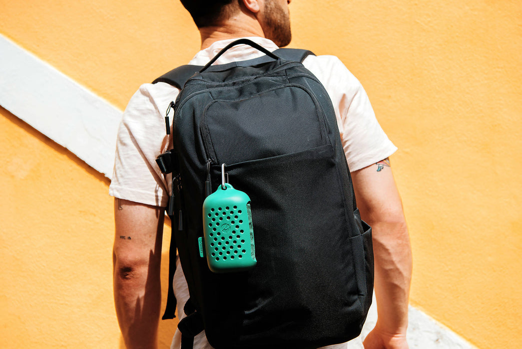 Matador NanoDry Towel Large - Forest - Man wearing the carrying case attached to a backpack