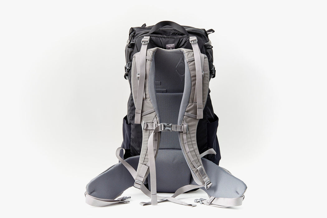 Mystery Ranch Scree 32 Backpack - Black - back view of bag standing upright, showing padded straps