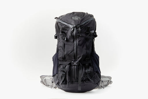 Mystery Ranch Scree 32 Backpack - Black - front view of bag standing upright