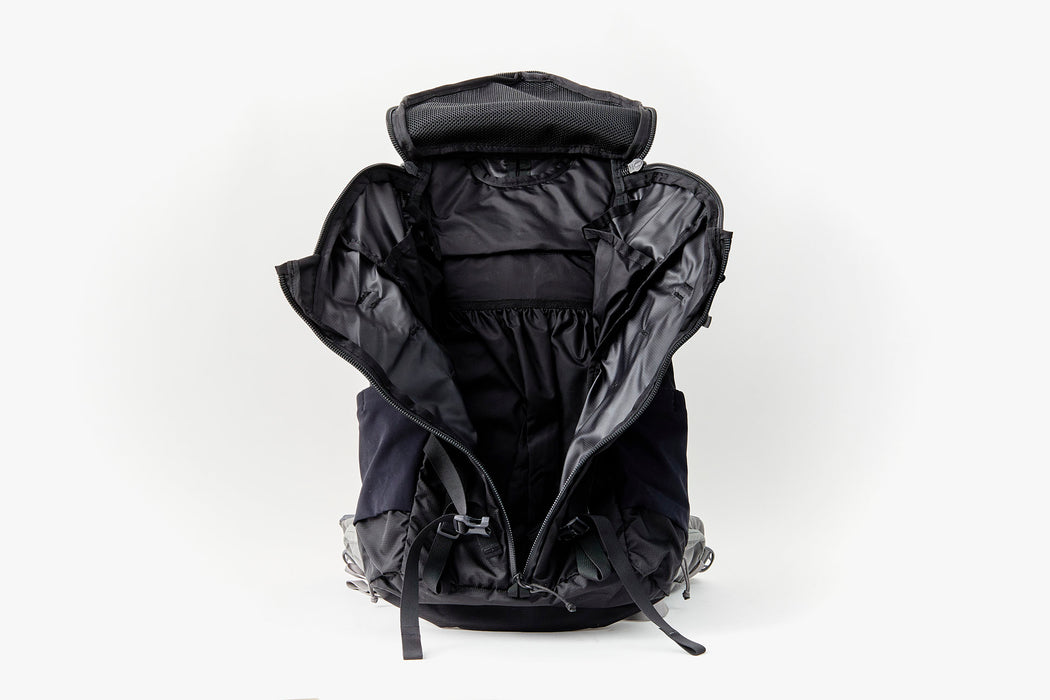 Mystery Ranch Scree 32 Backpack - Black - front view of bag, unzipped, showing interior