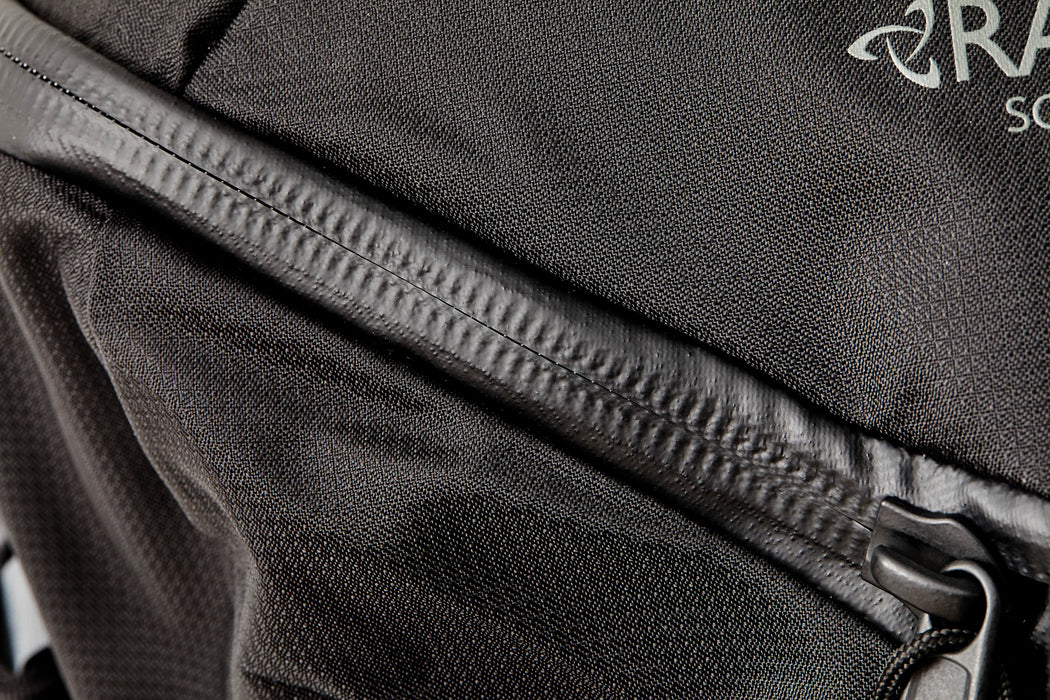 Mystery Ranch Scree 32 Backpack - Black - close-up view of waterproof seam detail on zipper