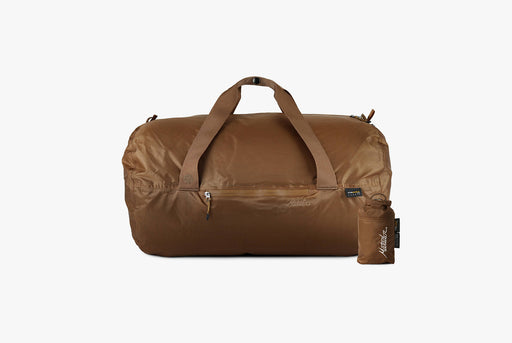 Matador Transit30 2.0 Duffel Bag - Coyote - front view of duffel next to compact carrying case