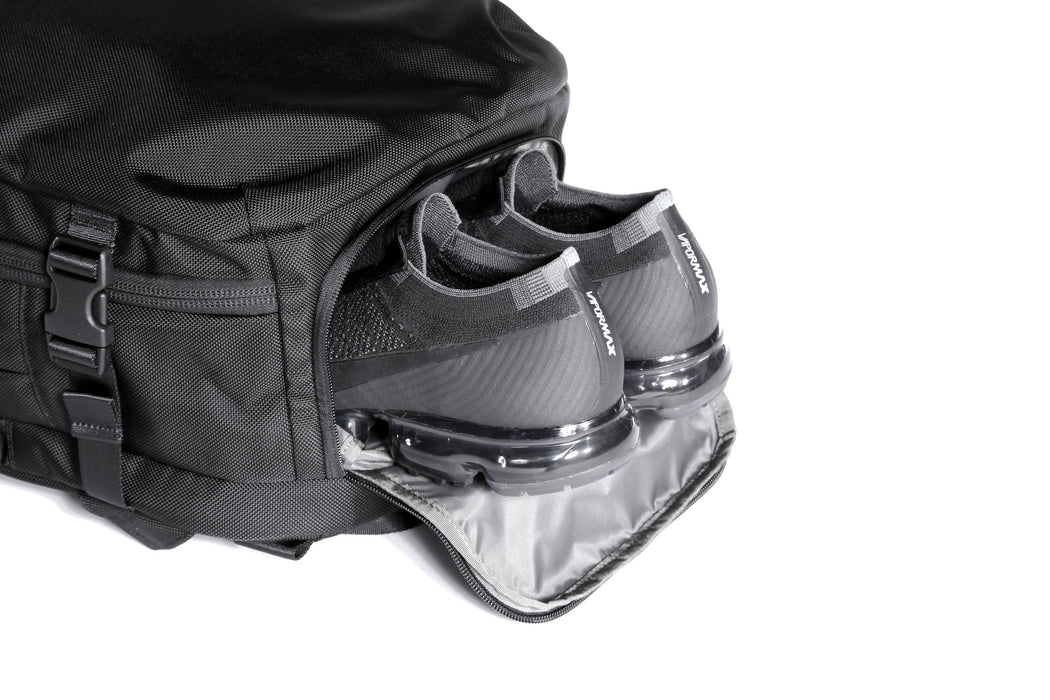 Black Travel Pack - Shoe Compartment Close-up with Sneakers