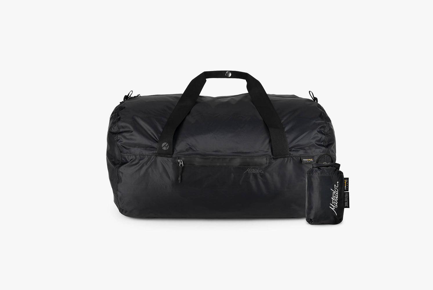 Matador Transit30 2.0 Duffel Bag - Black - front view of duffel next to compact carrying case