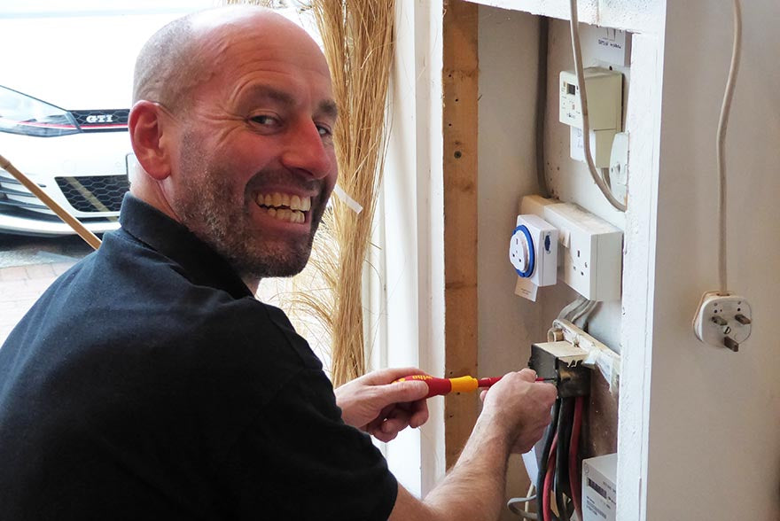 Jeff Smith at Work Replacing a Coommercial Fuseboard in a Travel Agents