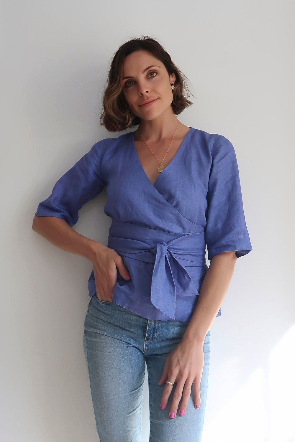 Blue, lilac linen top with tie waist belt. Cross over top