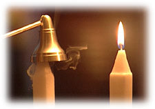Extinguish a candle with a snuffer